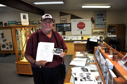 Randy Ross with father's CCC Discharge Papers